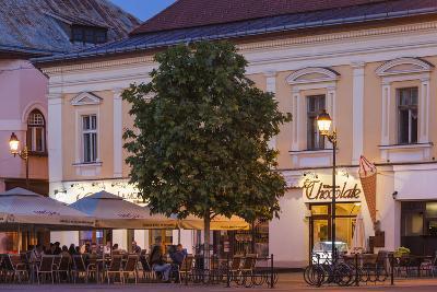 Romania, Baia Mare, Piata Libertatii Square, Outdoor Cafes, Dusk-Walter Bibikow-Photographic Print