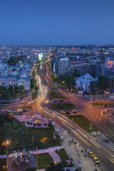 Romania, Bucharest, Piata Universitatii, Coltea Hospital at Dusk-Walter Bibikow-Photographic Print