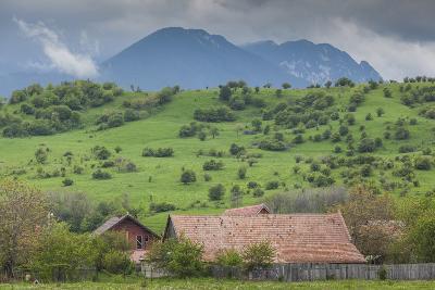 Romania, Transylvania, Bran, House and Bucegi Mountains, Spring-Walter Bibikow-Photographic Print