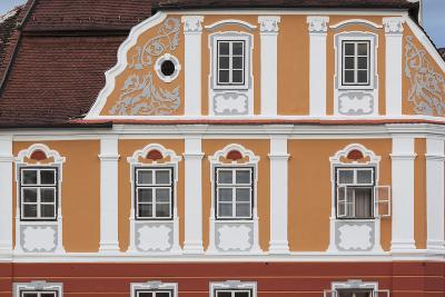 Romania, Transylvania, Sibiu, Piata Mare Square, Building Detail-Walter Bibikow-Photographic Print