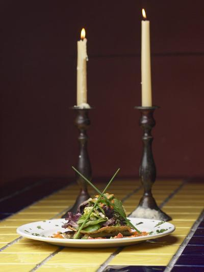 Romantic Gourmet Meal and Tall Candles Candles on Table in Restaurant--Photographic Print