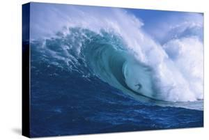 Surfer Shooting the Curl of Jaws at Peahi on Maui by Ron Dahlquist