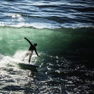 A Male Surfer Rides An Emerald Colored Wave In The Pacific Ocean Off The Coast Of Santa Cruz by Ron Koeberer