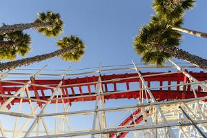 Low Angle View Of The Giant Dipper Roller Coaster Ride At The Santa Cruz Beach Boardwalk In CA by Ron Koeberer
