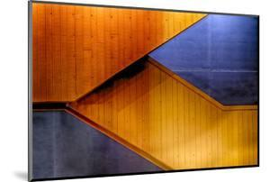 Graphic Composition of Orange Stairs Against a Blue Wall by Rona Schwarz