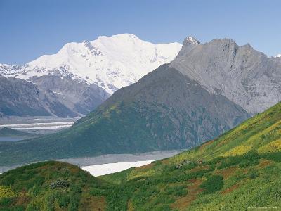Root Glacier, Mount Blackburn and Donoho Peak Loom above a Green Hill-Rich Reid-Photographic Print