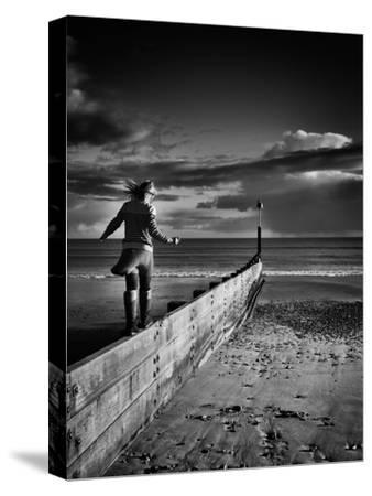 Girl Walking on Sea Defence