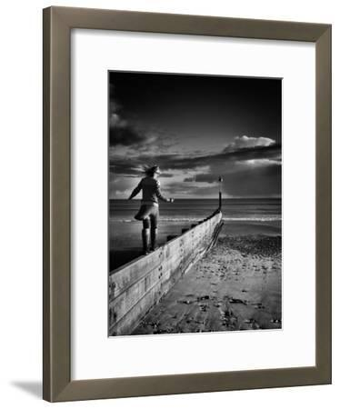 Girl Walking on Sea Defence