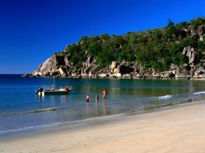 Father and Daughters Enjoying Waters of Radical Bay, Magnetic Island, Australia