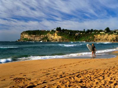 Surfer on Avalon Beach, Bilgola Headland in Background, Sydney, New South Wales, Australia