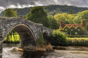 Bridge and ivy covered cottage, Conwy Valley, North Wales, UK by Ross Hoddinott