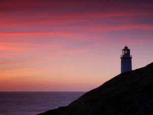 Trevose Lighthouse at Sunset, Near Padstow, Cornwall, Uk. July 2008 by Ross Hoddinott