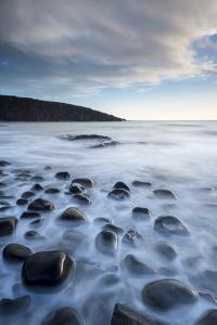 Waves washing over the rocks, Northumberland, UK by Ross Hoddinott