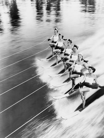 https://imgc.artprintimages.com/img/print/row-of-women-water-skiing_u-l-q19yrc30.jpg?p=0