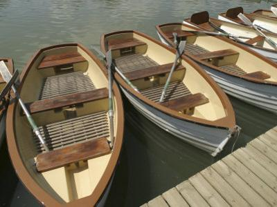 Rowboats with Oars Alongside a Dock
