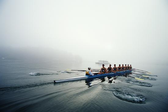 Rowing Team on Lake in Early Morning Fog-Nick Wilson-Photographic Print