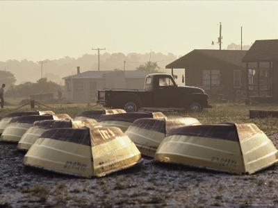 Rows of Upturned Wooden Rowboats on Chincoteague Island-Medford Taylor-Photographic Print