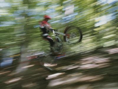 A Boy Flies Through the Air on His Mountain Bike