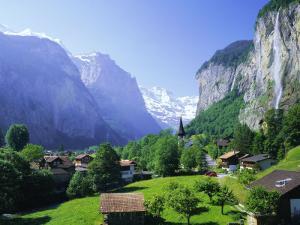 Lauterbrunnen and Staubbach Falls, Jungfrau Region, Swiss Alps, Switzerland, Europe by Roy Rainford
