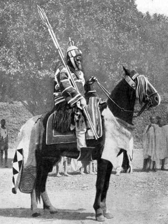 Royal Bodyguard in Ancient Armour, Northern Nigeria, 1936