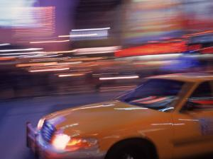 Blurred View of Taxi Cab in Times Square, NYC by Rudi Von Briel