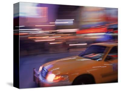 Blurred View of Taxi Cab in Times Square, NYC