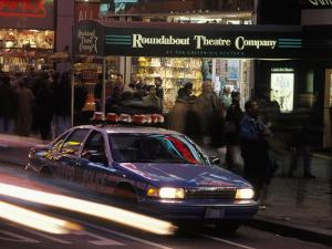Police Car in Times Square, NYC by Rudi Von Briel