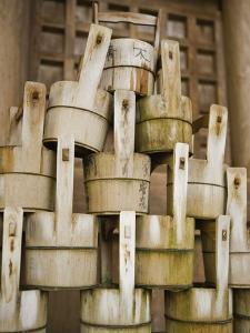 Buckets Stacked at Yasaka Shrine in Kyoto by Rudy Sulgan