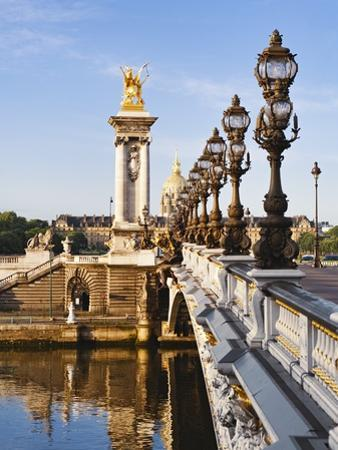 Pont Alexandre-III and Dome des Invalides over Seine river
