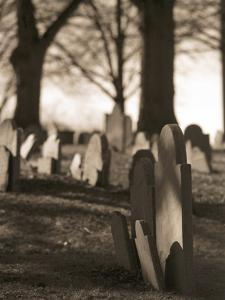Tombstones in cemetery by Rudy Sulgan
