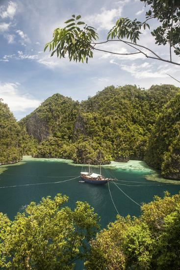 Rugged Limestone Islands Frame an Indonesian Pinisi Schooner-Stocktrek Images-Photographic Print
