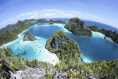 Rugged Limestone Islands Surround a Gorgeous Lagoon in Raja Ampat-Stocktrek Images-Photographic Print