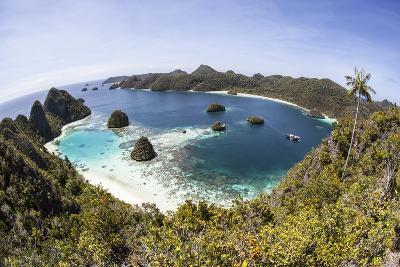 Rugged Limestone Islands Surround a Gorgeous Lagoon in Raja Ampat-Stocktrek Images-Photographic Print