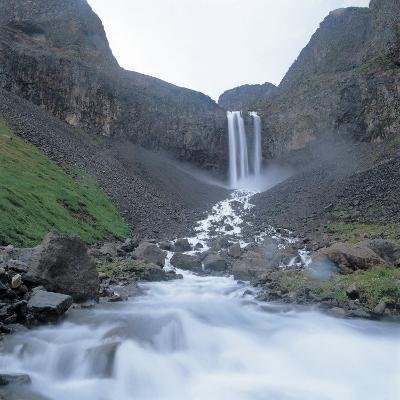 Rushing and Cascading Waterfall Between Mountains--Photographic Print