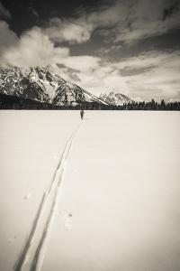 Backcountry skier under Mount Moran, Grand Teton National Park, Wyoming, USA by Russ Bishop