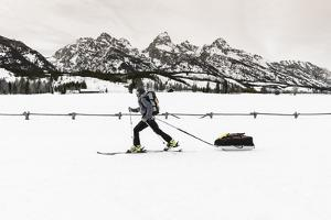 Backcountry skier under the Tetons, Grand Teton National Park, Wyoming, USA by Russ Bishop