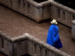 Ecuador, Lady Crossing Bridge by Russell Burden