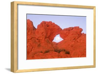 Kissing Camels Formation with Full Moon in Arch in Garden of the Gods Park in Colorado Springs Colo