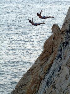 Cliff Divers, Guerrero, Mexico by Russell Gordon