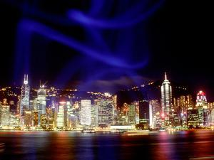 Skyline at Night Reflected in Victoria Harbour, Kowloon, Hong Kong by Russell Gordon