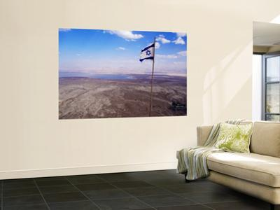 The Blue and White Flag of Israel, the Star of David Flies over the Deserts of Masad