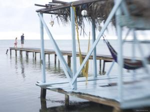 Jetty and Hammocks, Caye Caulker, Belize by Russell Young