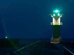 Jetty Lighthouse, Warnemunde, Germany by Russell Young