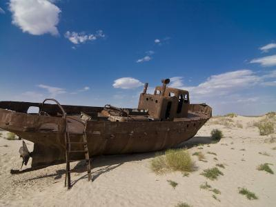 Rusting Boats Lying in the Desert Which Used to Be the Aral Sea, Moynaq, Uzbekistan, Central Asia-Michael Runkel-Photographic Print