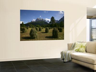 Haystacks in Field with Croda Rossa Dolomite Peaks in Distance