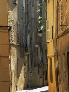 Narrow Sunlit Street in Old Aix, Provence-Alpes-Cote-D'Azur, France by Ruth Tomlinson