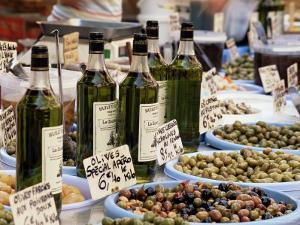 Olives and Olive Oil on Sale at a Market, Provence-Alpes-Cote-D'Azur, France by Ruth Tomlinson