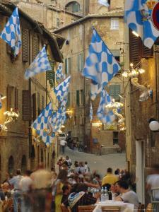 Palio Banquet for Members of the Onda (Wave) Contrada, Siena, Tuscany, Italy, Europe by Ruth Tomlinson
