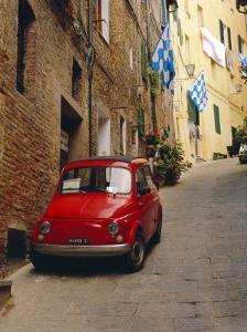 Red Car Parked in Narrow Street, Siena, Tuscany, Italy by Ruth Tomlinson