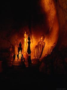 Standing Buddha Statues at Tham Phum Caves, Pak Ou Caves (Mouth of the Ou), Luang Prabang, Laos by Ryan Fox